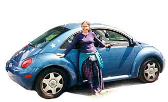 Lynn with her 1998 New Beetle, Joy